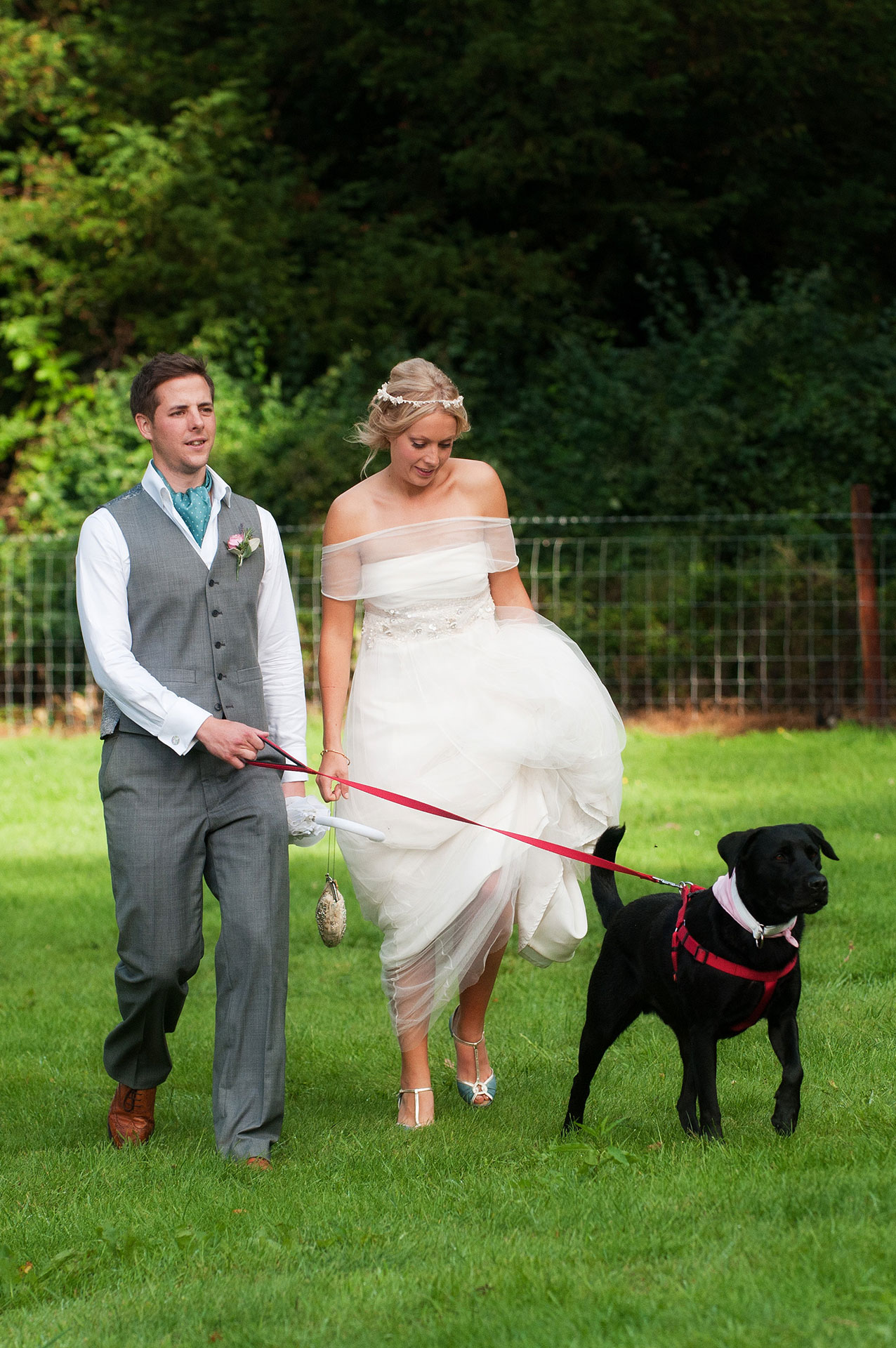Portrait of Mark & Emily with their dog at Pipewell Hall
