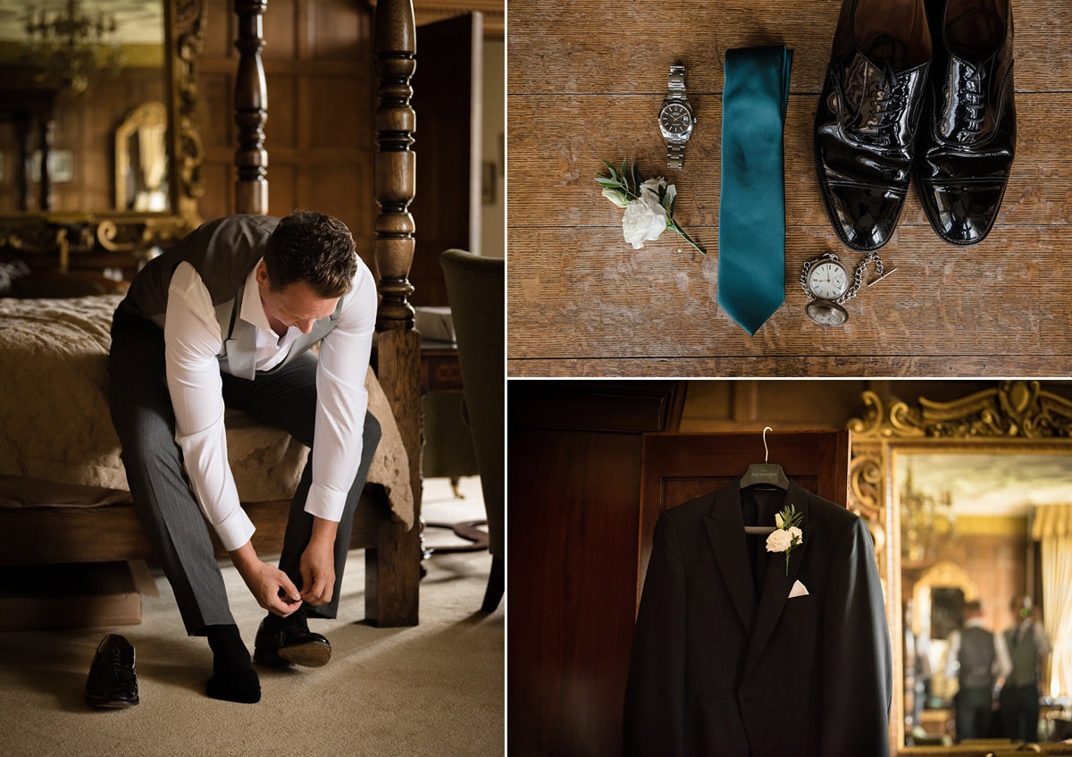 Groom putting his shoes on in the Oak Suite at Rushton Hall
