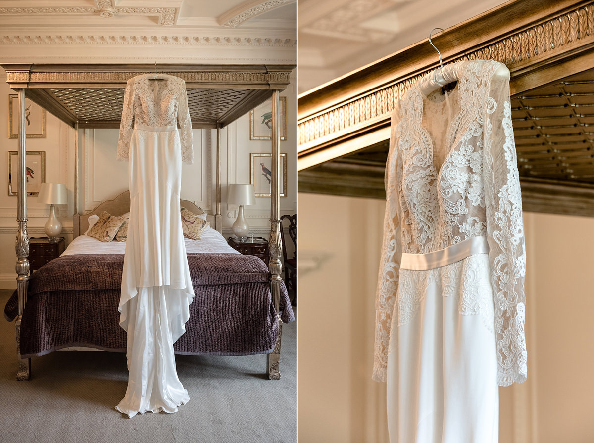 Bride's Suzanne Neville dress hanging in The Georgian Suite at Rushton Hall