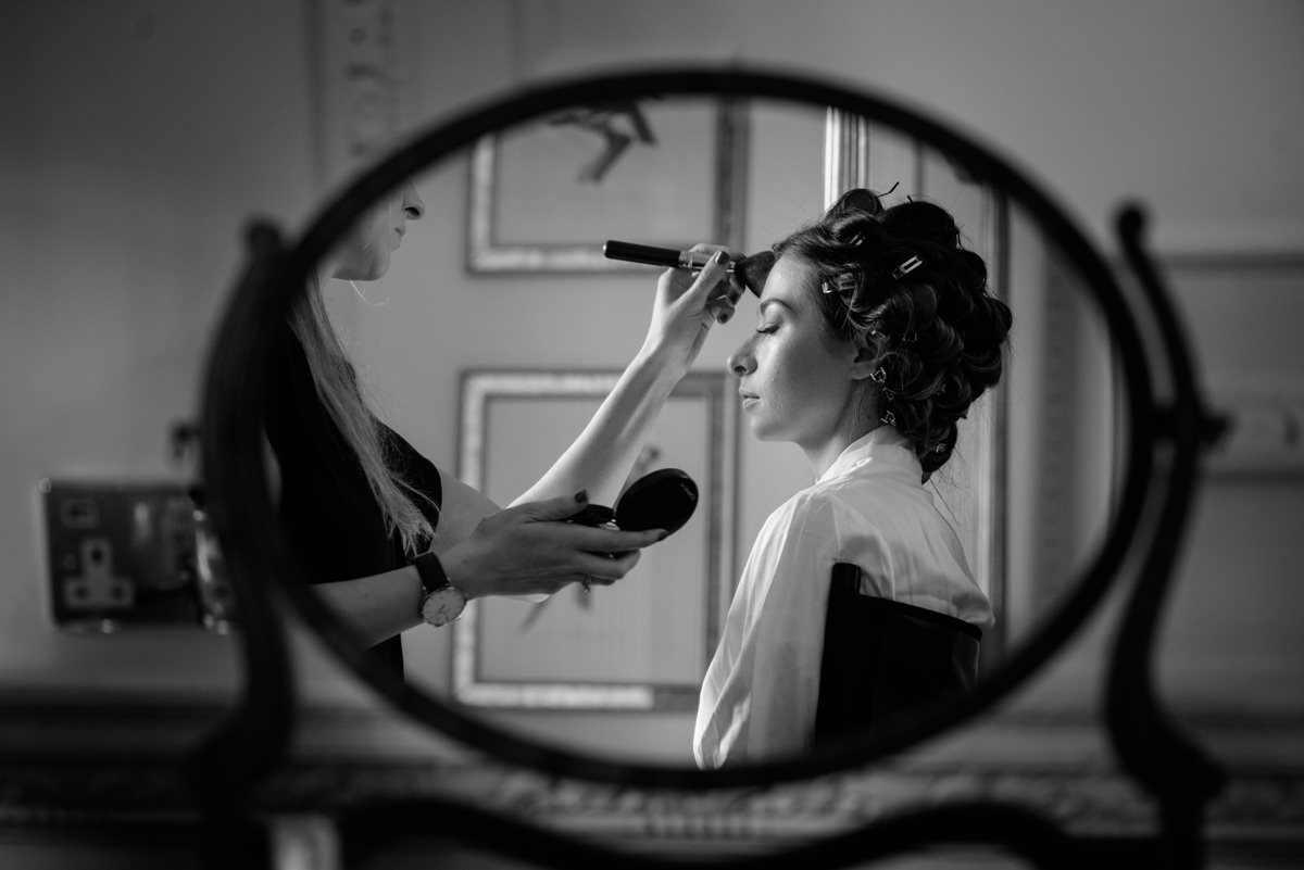 Bride having her make-up done in The Georgian Suite at Rushton Hall