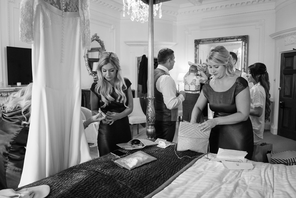 Bridesmaids packing their bags in The Georgian Suite at Rushton Hall
