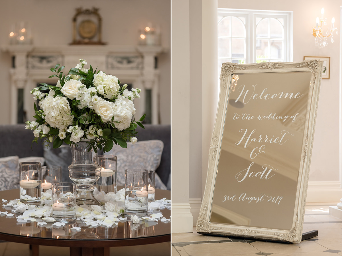 Wedding signage and flowers in the Orangery at Rushton Hall