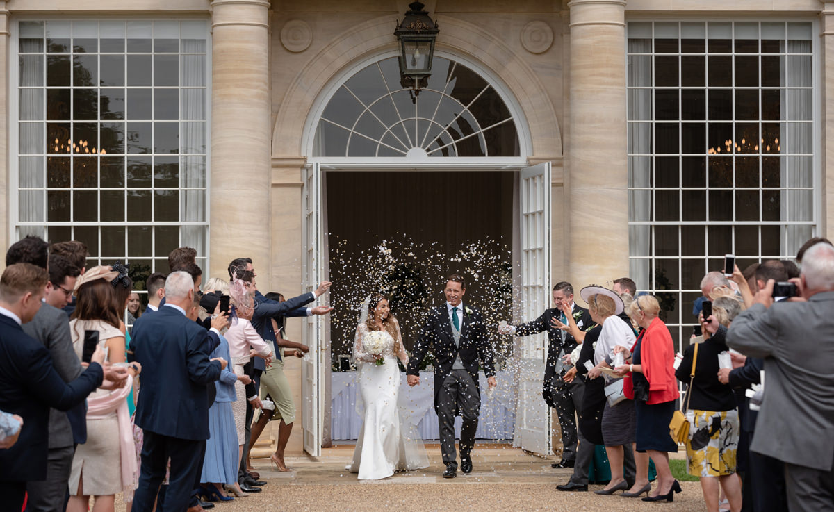 Confetti in front of the orangery at Rushton Hall