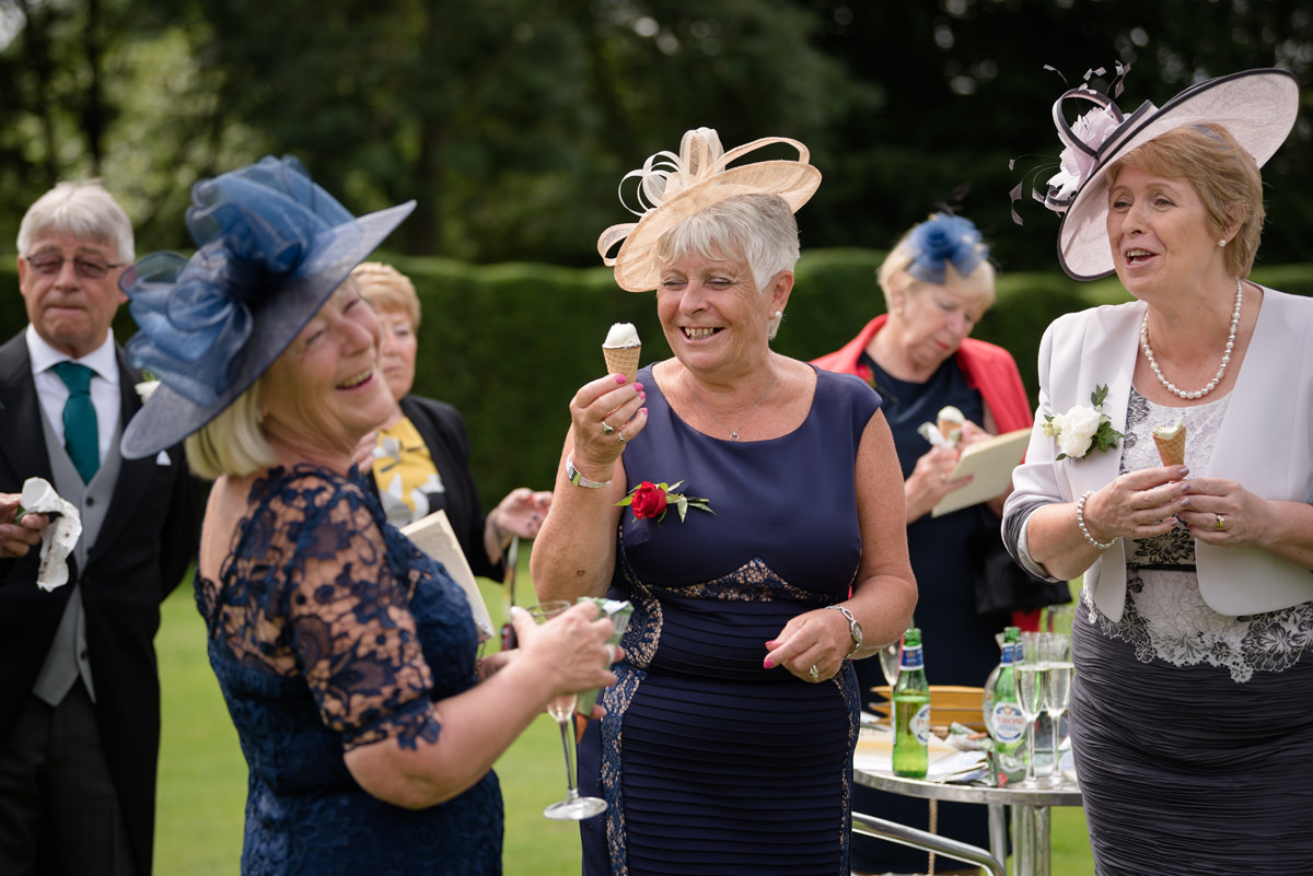 Guests enjoying ice creams during a wedding reception at Rushton Hall