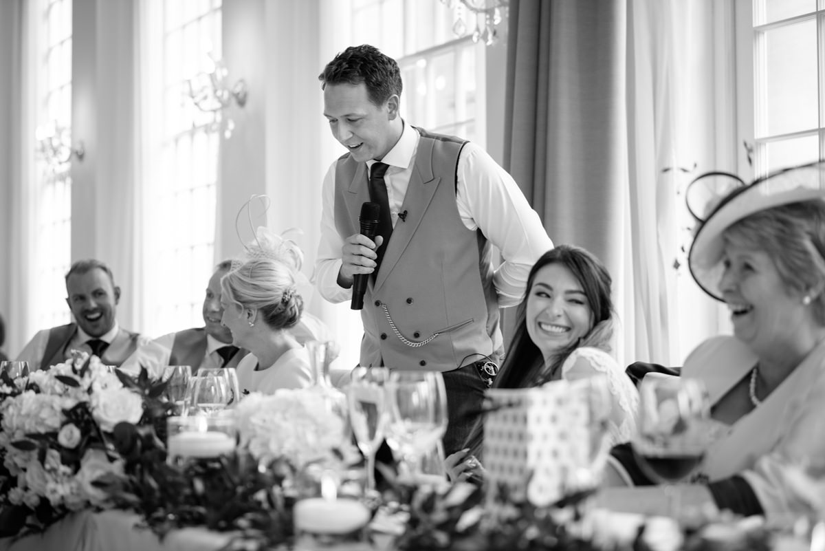 Groom making a speech in the orangery at Rushton Hall