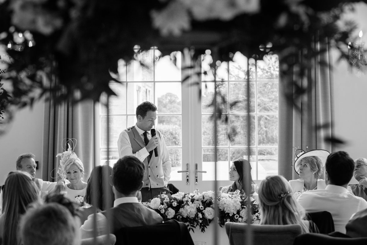 Groom speaking about the bride during his speech at Rushton Hall