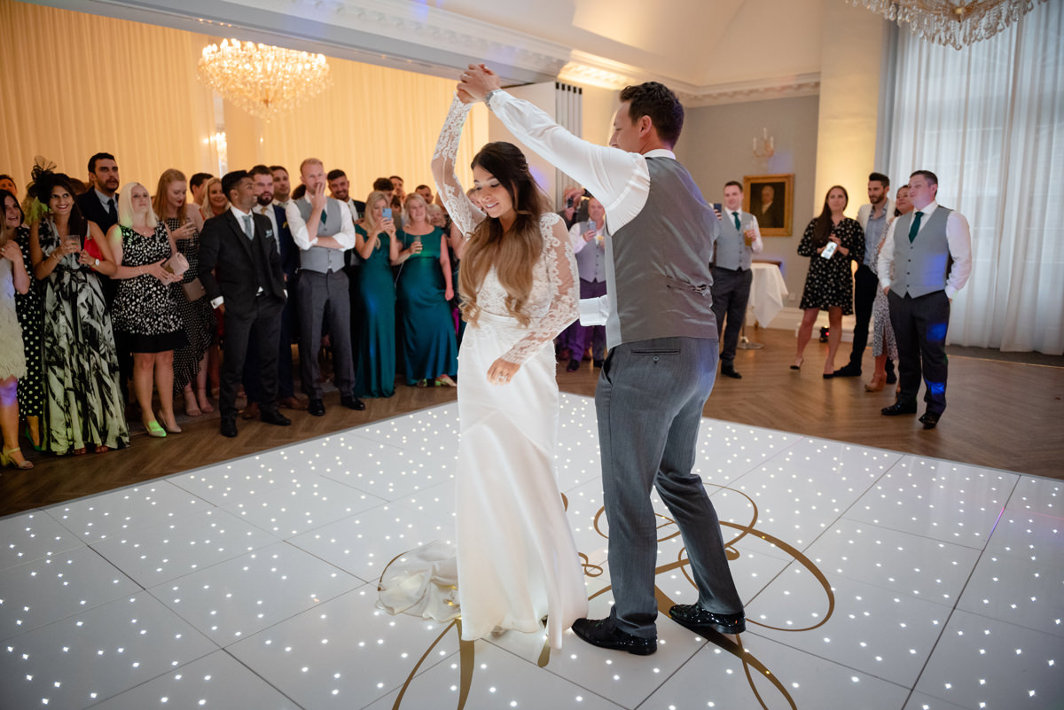 Bride and groom's first dance in the State Room in the Orangery at Rushton Hall