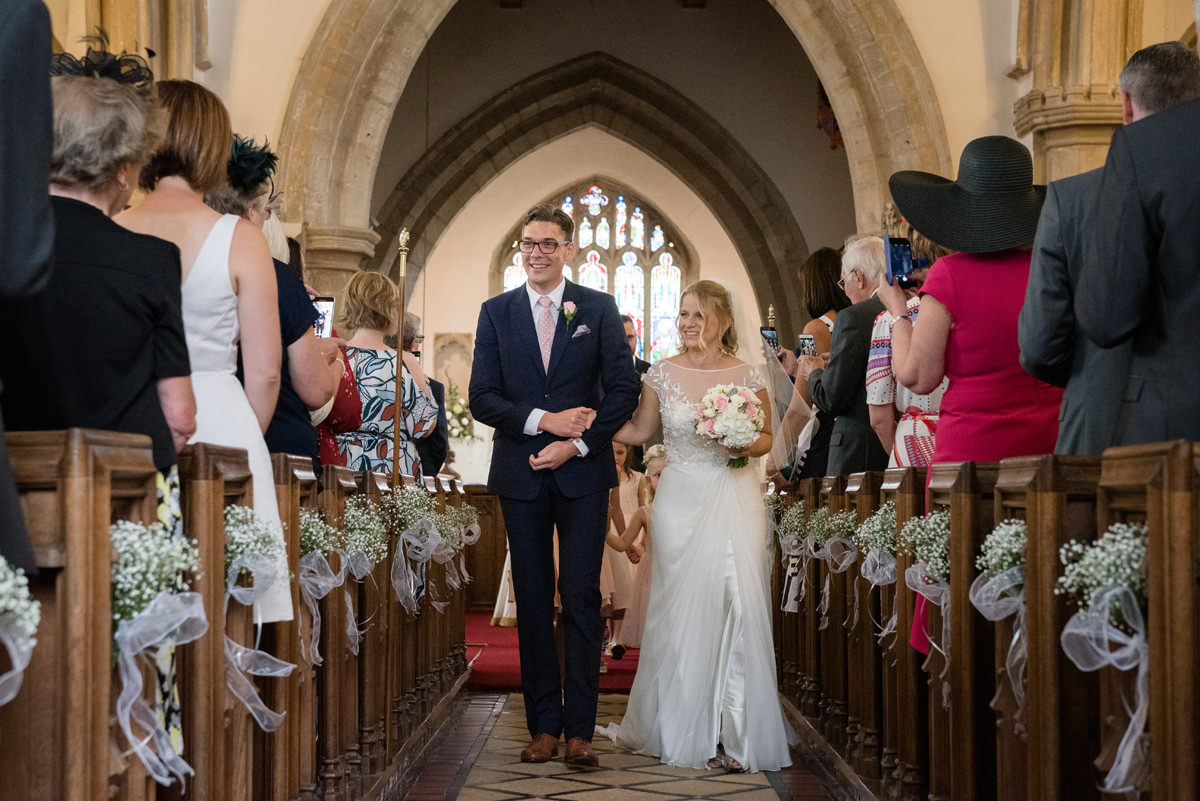 Walking down aisle at Kings Cliffe church