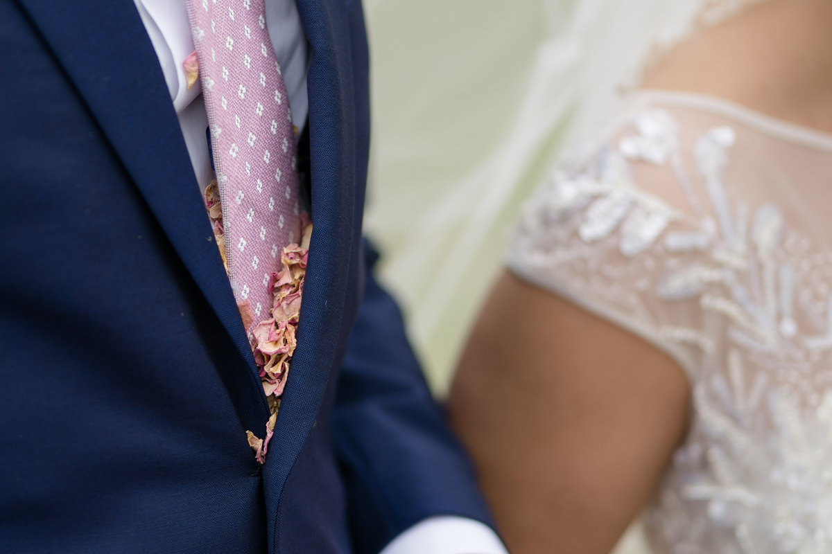 Confetti stuck inside groom's suit