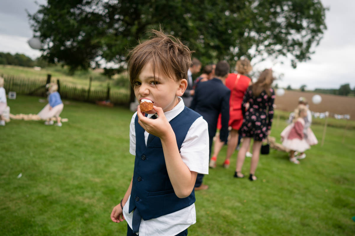 Page boy eating a scotch egg canape