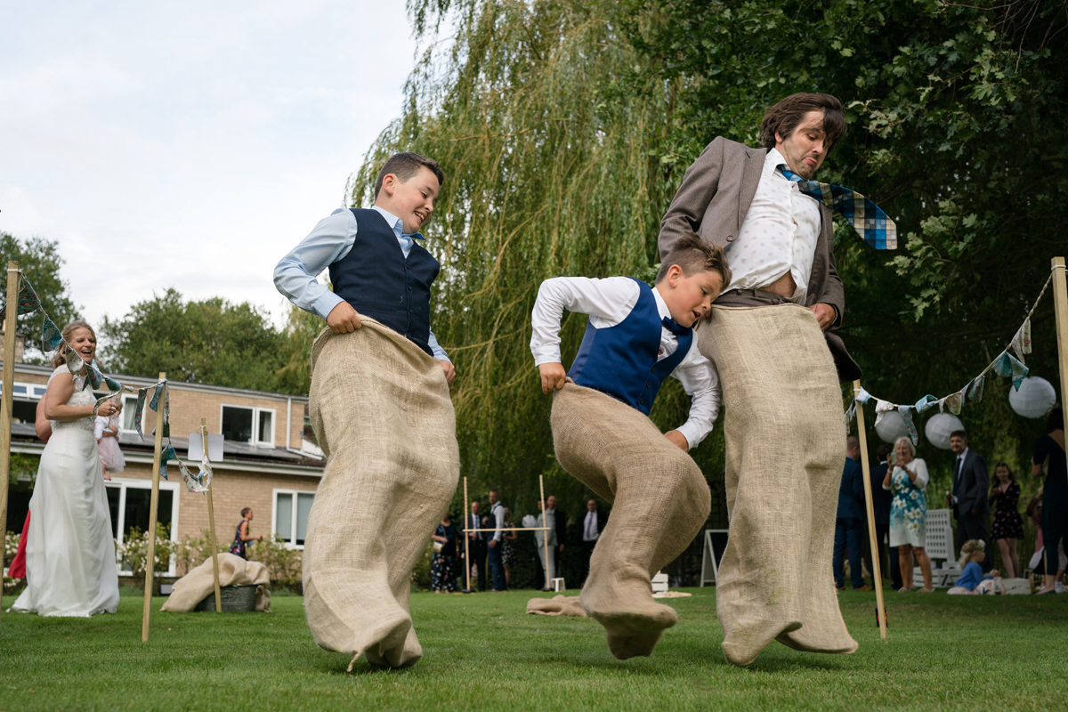 Competitive sack race at a wedding