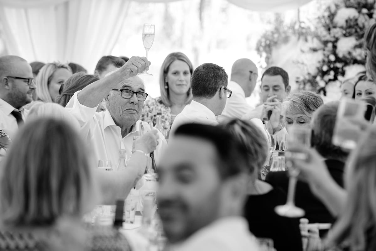 Father of groom raising his glass for toast