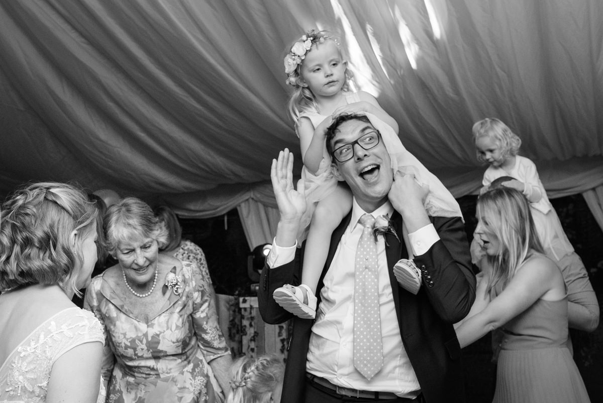 Groom with daughter on his shoulders