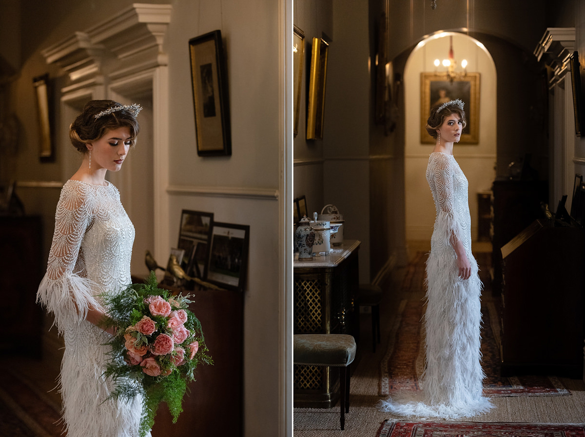 Model wearing an Eliza Jane Howell feather dress on the landing at Holdenby House