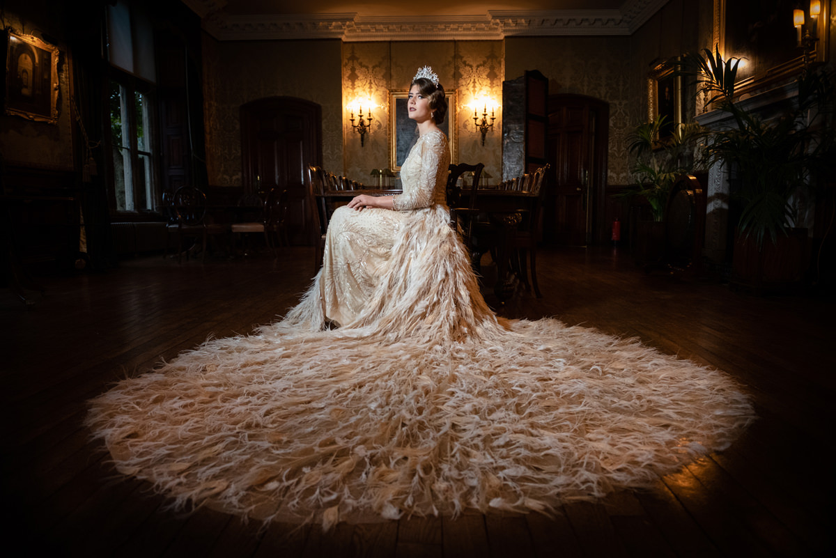 Model posing like a Queen in Eliza Jane Howell at Holdenby House