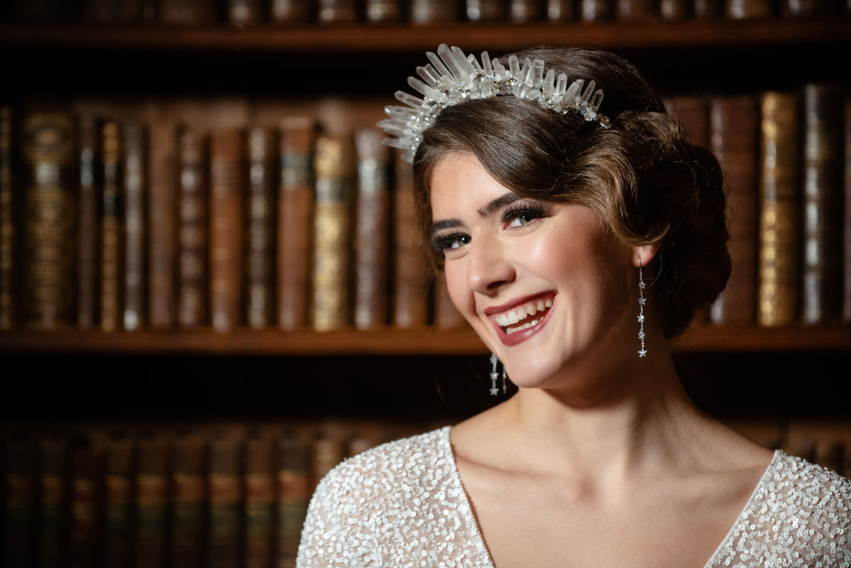 Model wearing Miss Clemmie tiara in the library at Holdenby House
