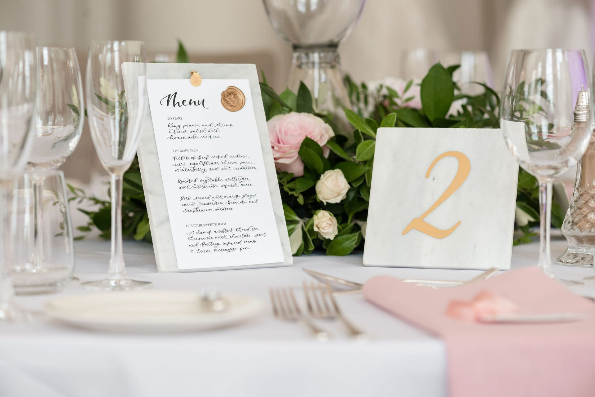 Marble wedding menu with calligraphy and gold details