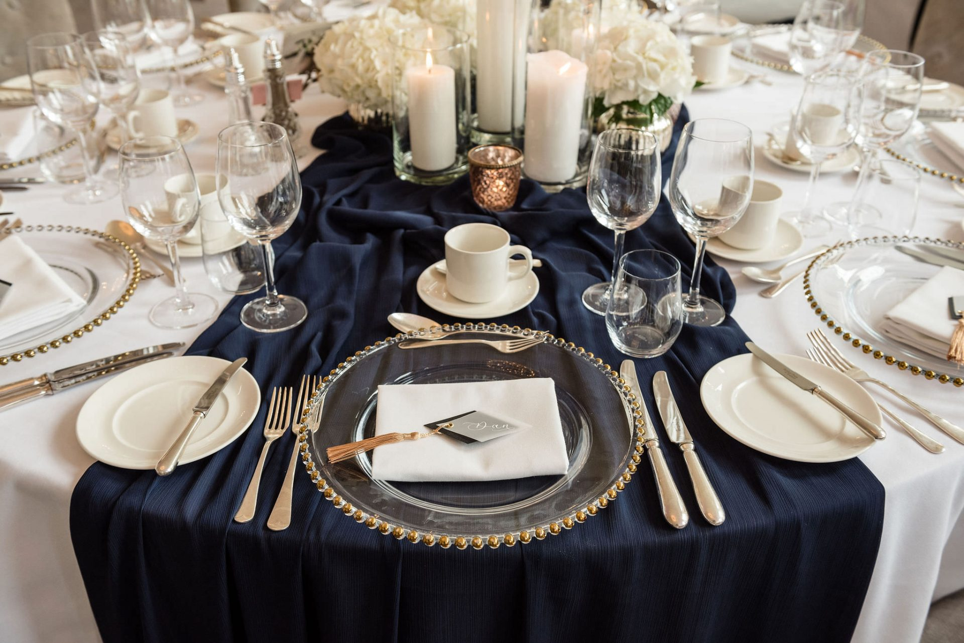 Navy, gold and white wedding table setting