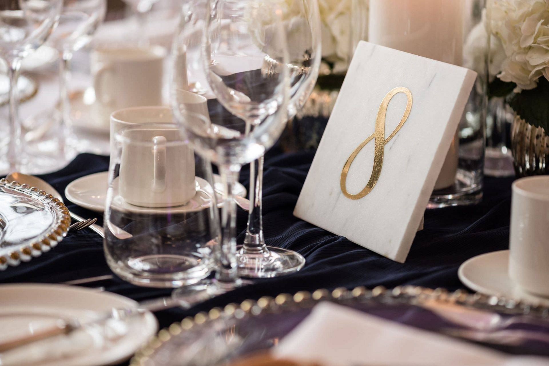 Marble and gold foil table number for a wedding