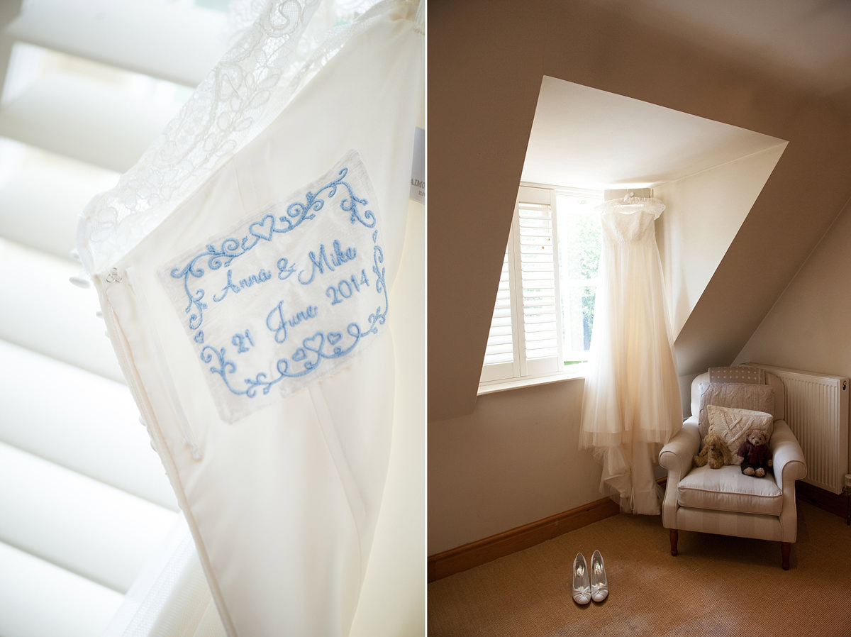 A Martin Charles Couture wedding dress hanging in a bedroom on a bride's wedding morning
