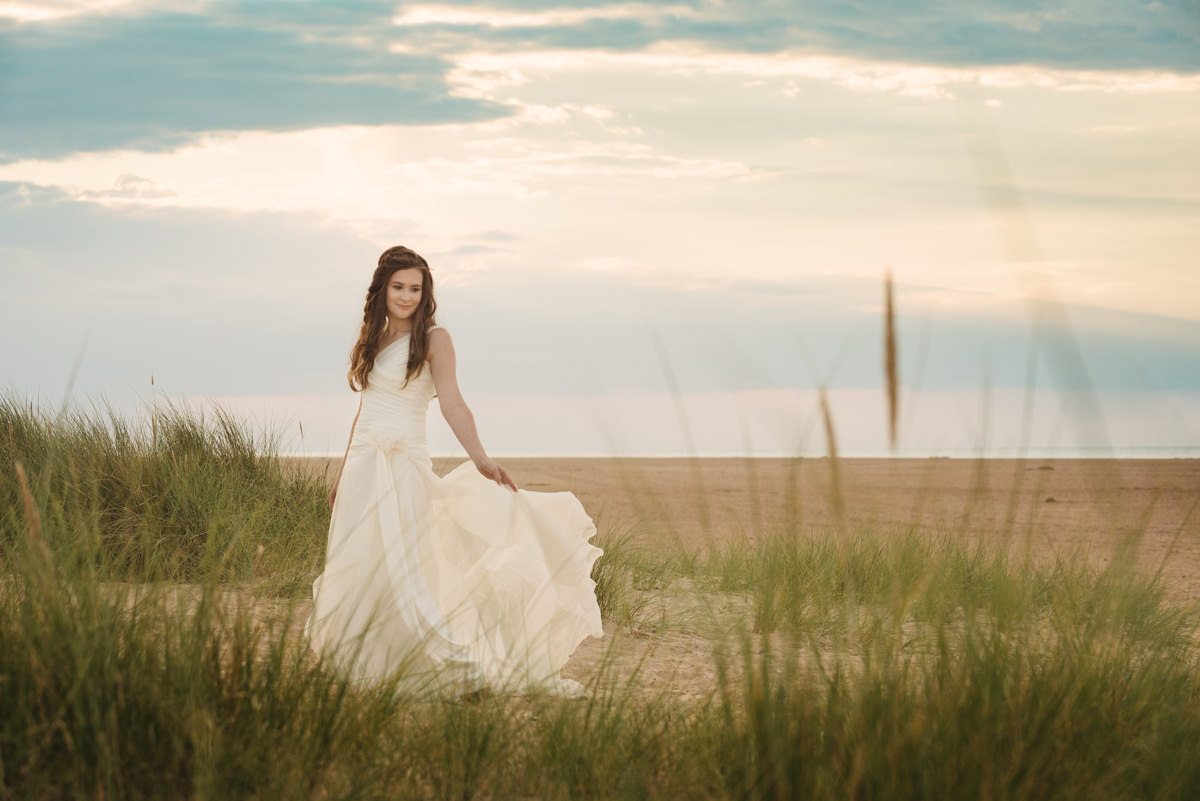 A bride wearing Martin Charles Couture on the beach in north Norfolk
