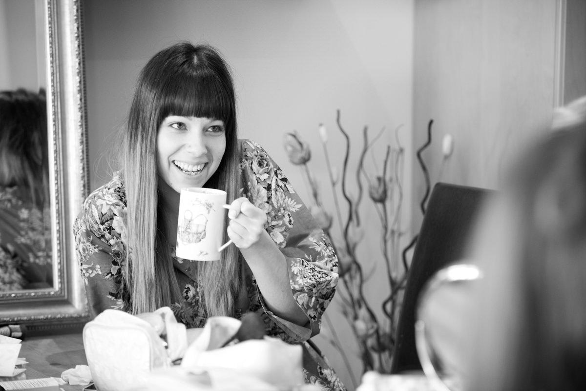 Bridesmaid drinking a mug of tea