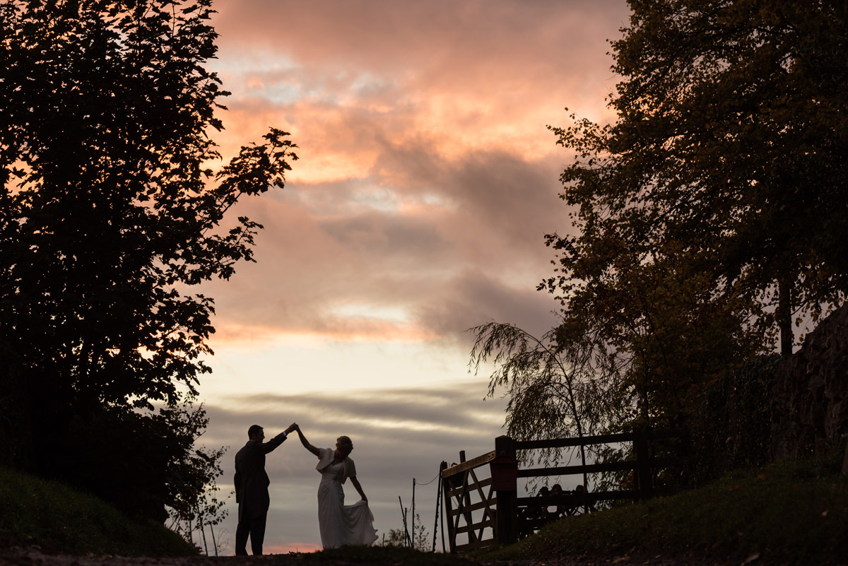 Bride and groom dancing at sunset at Dodford Manor