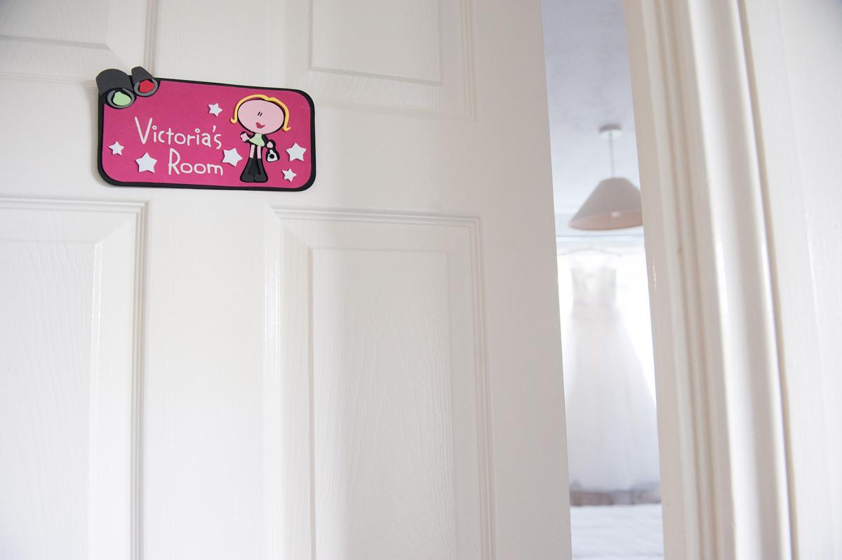 Bride's childhood bedroom door sign
