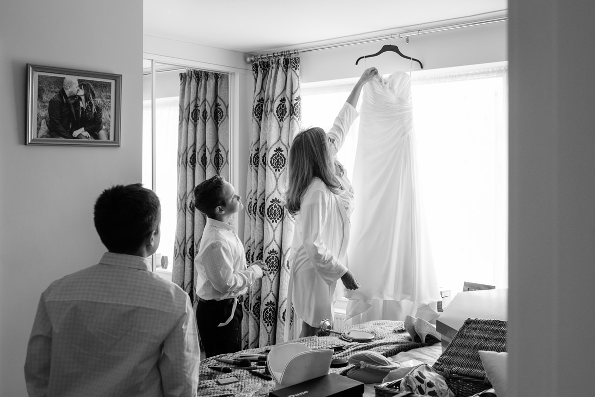 Bride showing her wedding dress to her two sons for the first time