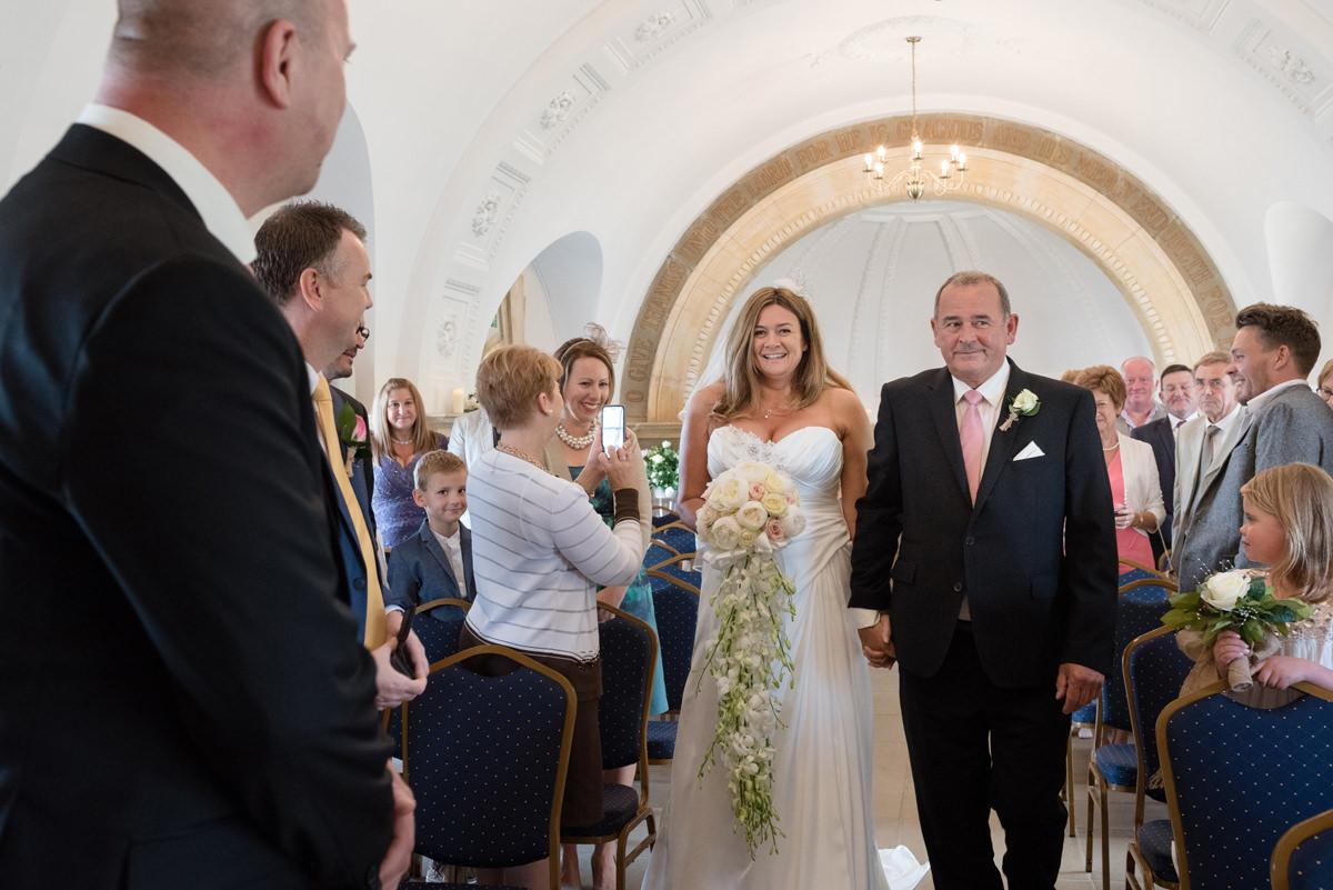 Bride walking down the aisle at Normanton Church
