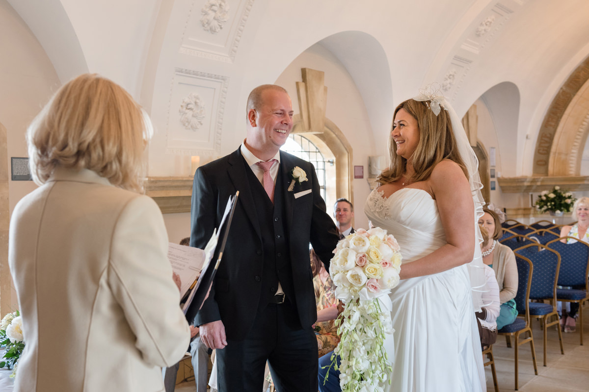 Bride and groom laughing during civil ceremony at Normanton Church