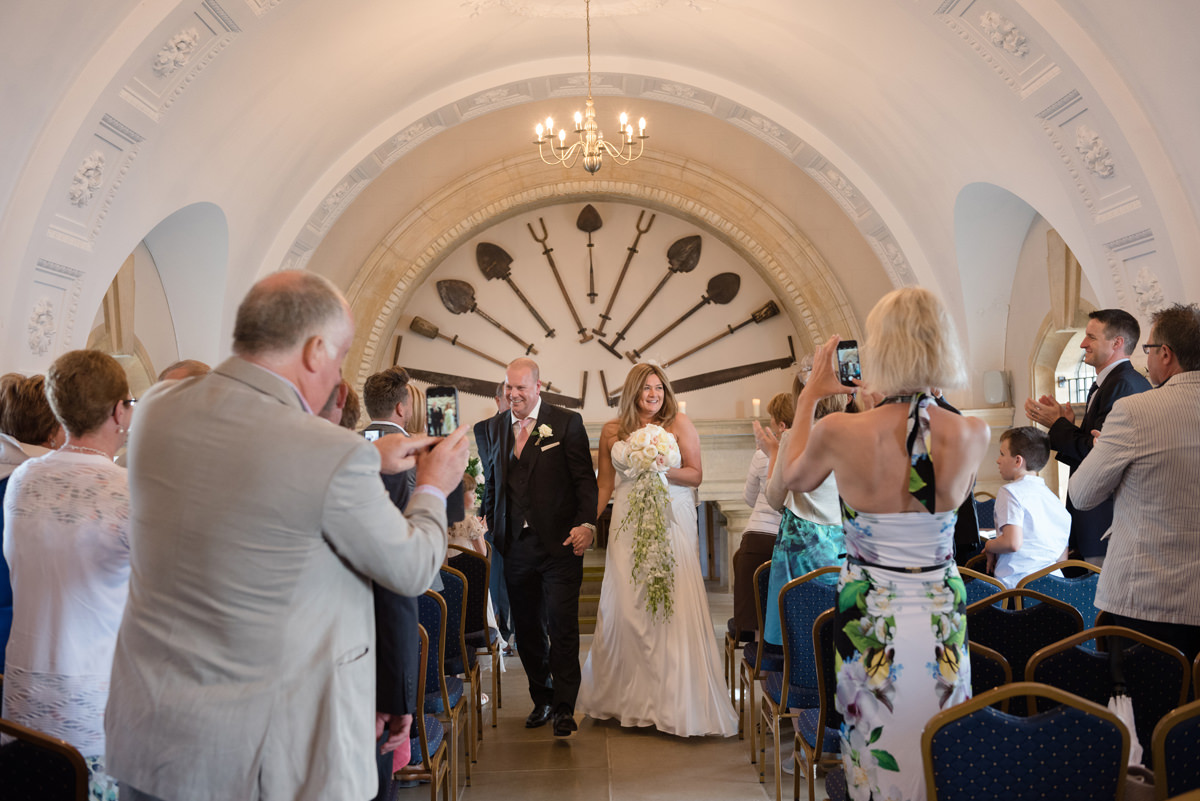 Bride and groom walking down the aisle at Normanton Church