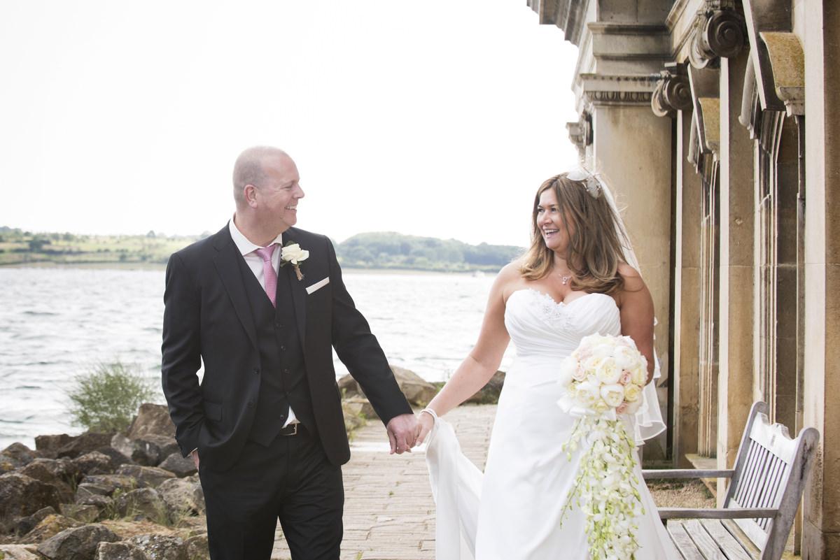 Bride and groom walking at Normanton Church