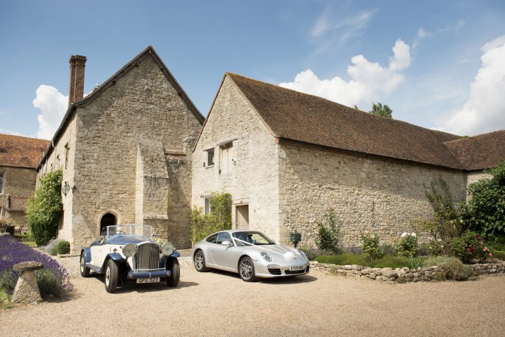 Vintage wedding cars in front of Notley Abbey