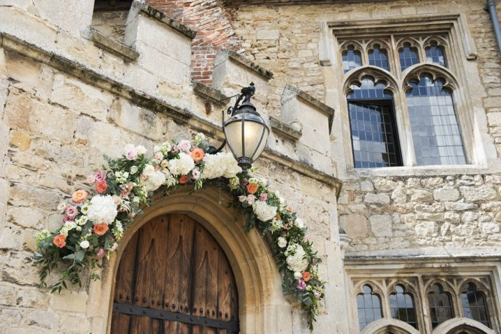 Flower arch around front door at Notley Abbey