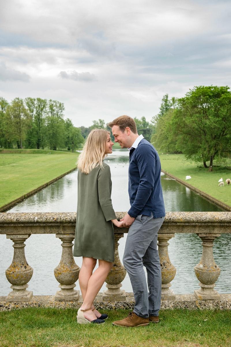 Engaged couple on bridge at Boughton House