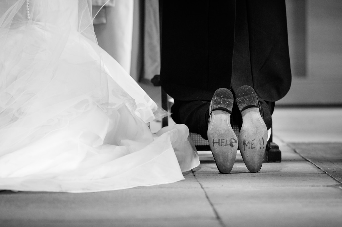 'Help me' written on the bottom of groom's shoes during the prayers