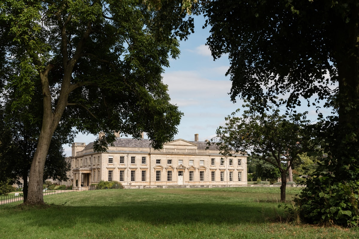 Lamport Hall through the trees