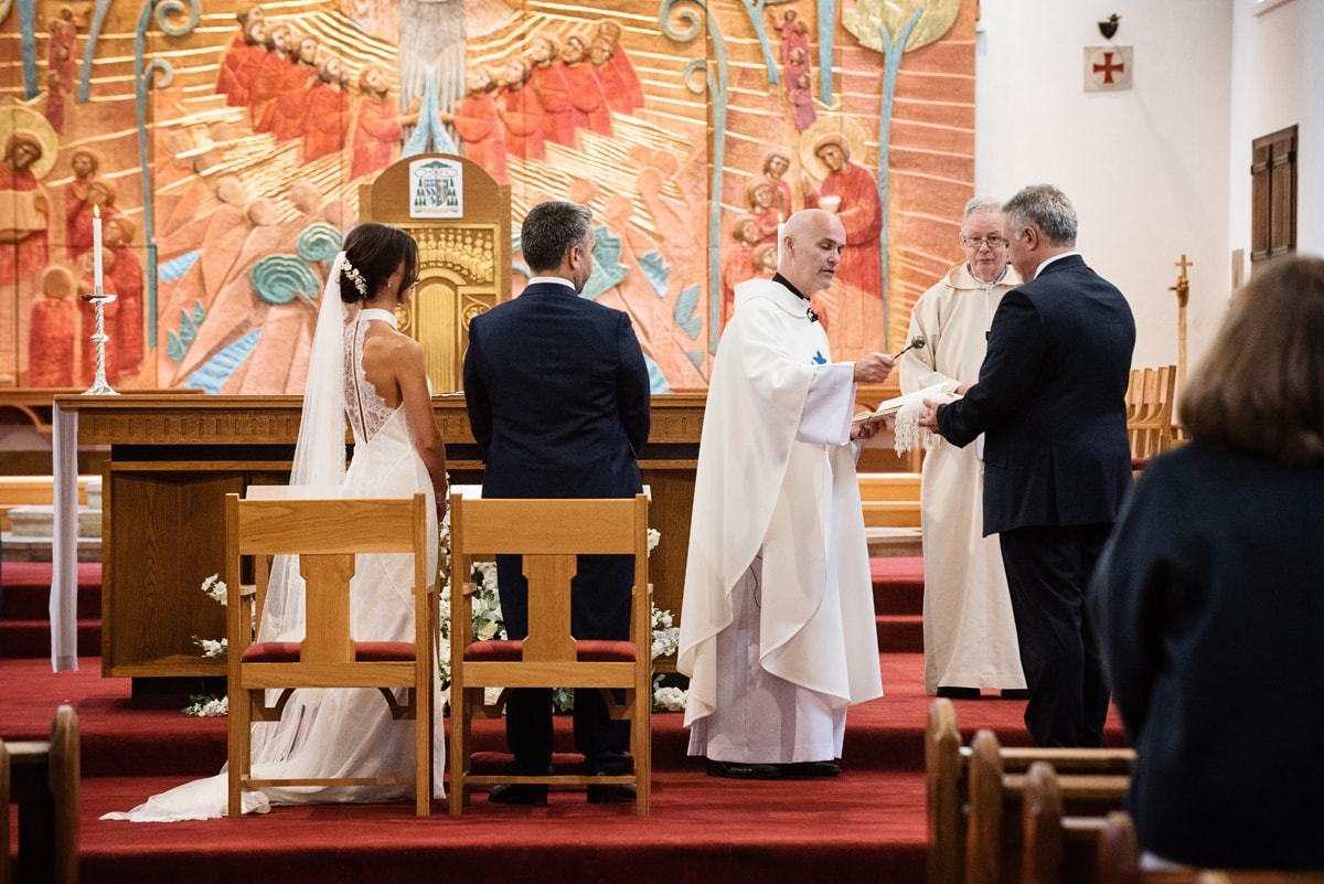 Priest leading marriage ceremony at Northampton Cathedral