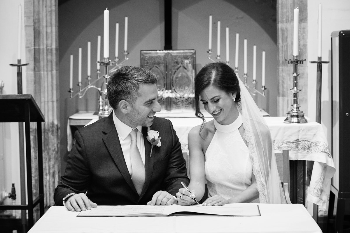 Couple signing the register after their intimate wedding