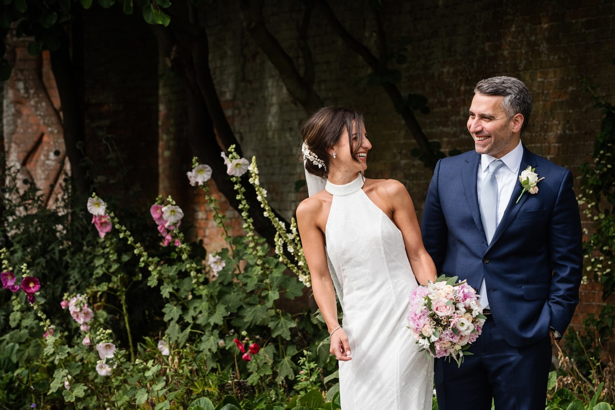 Couple laughing in walled garden at Delapre Abbey