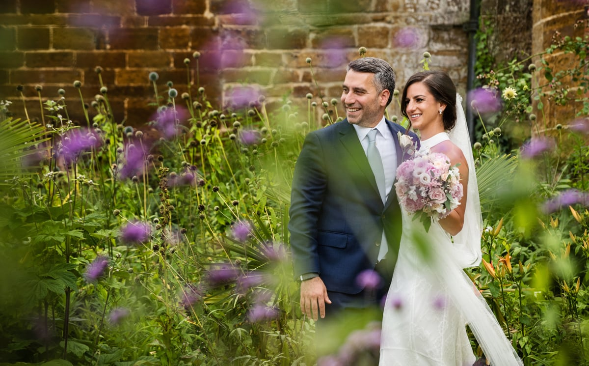 Bride & groom in walled garden at Delapre