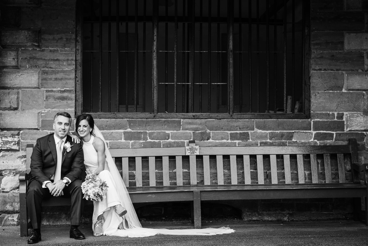 Just married couple sitting on bench