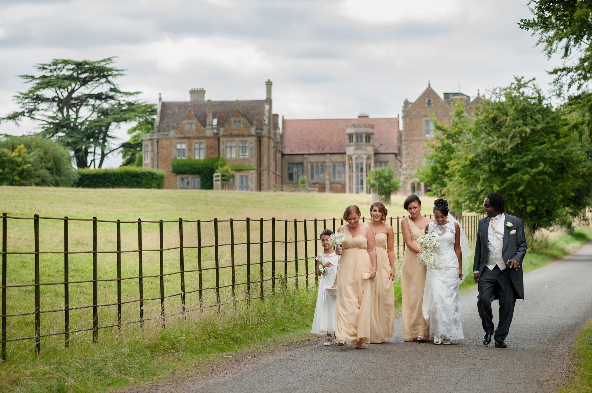 Bridal party walking to Fwsley Hall church 1001