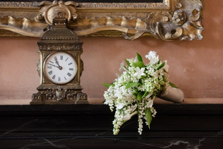 A clock on the mantlepiece in the Great Hall at Kelmarsh Hall