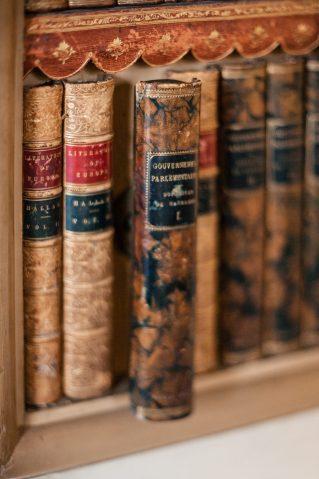A hidden door in the library at Kelmarsh Hall