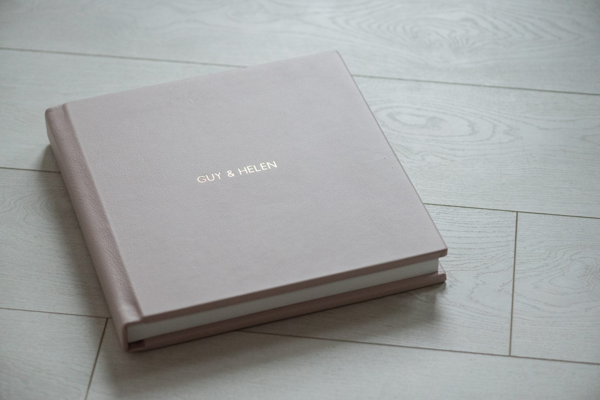 Blush pink cover with gold foil title