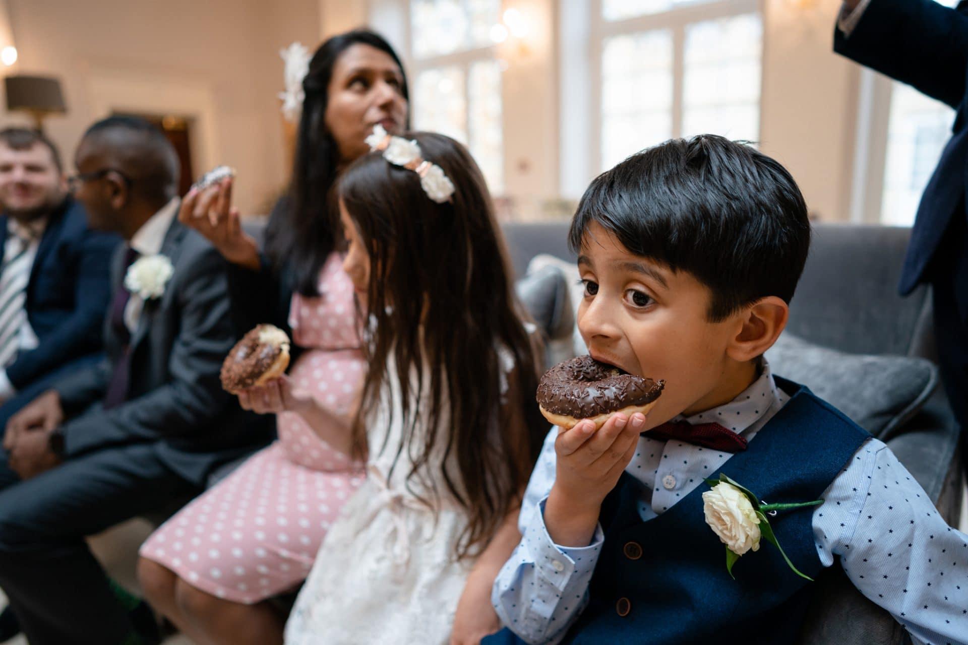 Kids eating doughnuts at a wedding