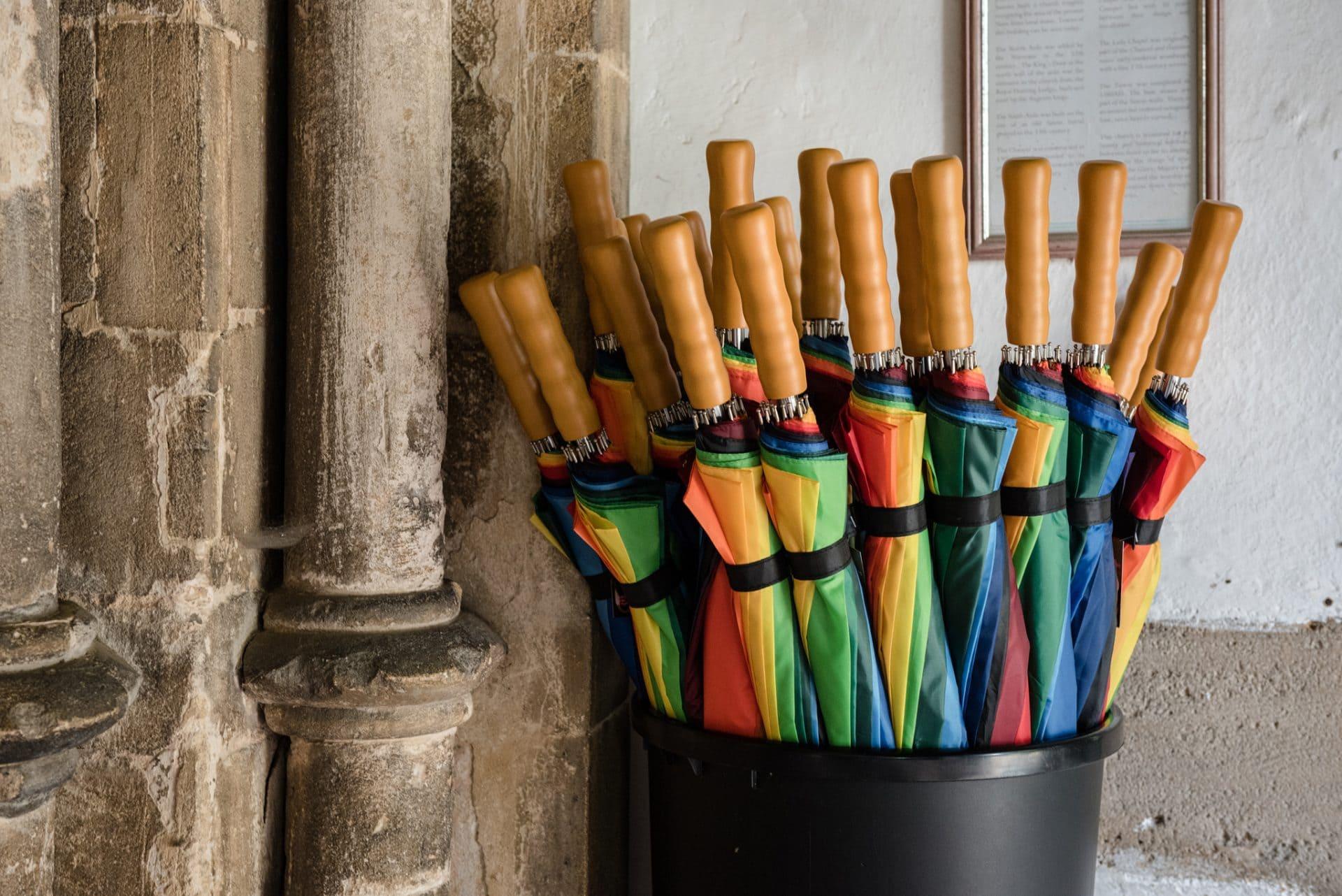 Rainbow umbrellas at a wedding