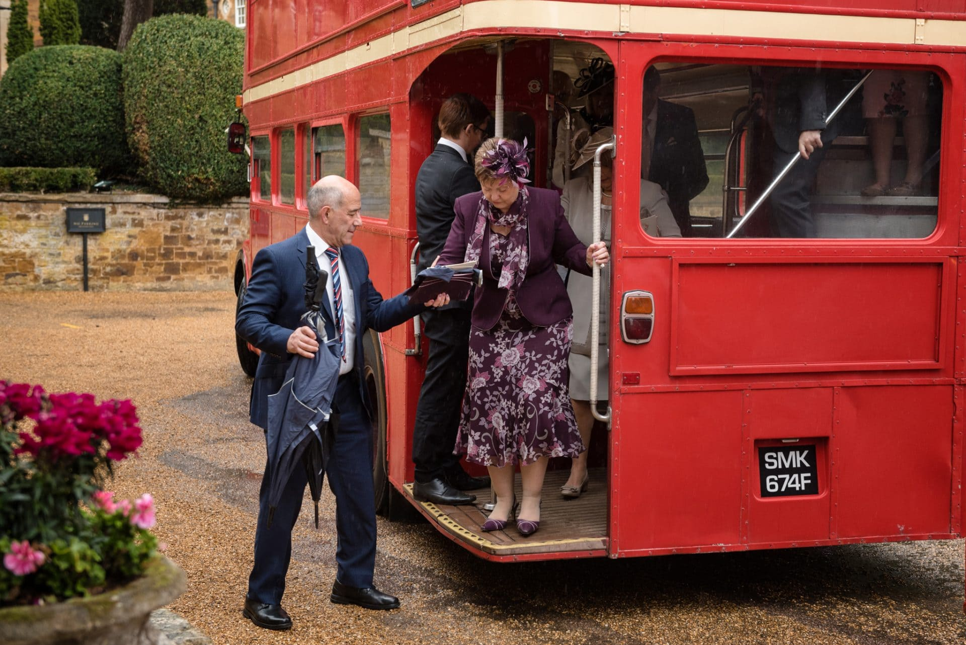 Red London bus at a wedding